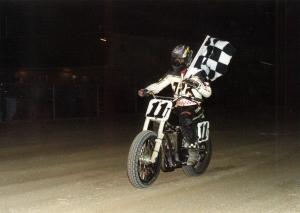 John Parker holding checkered flag